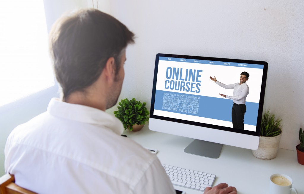 man taking online courses