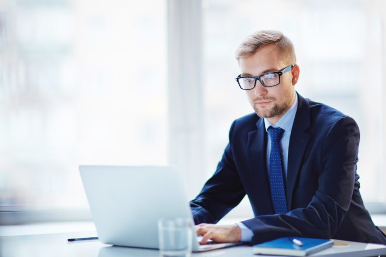 businessman with glassess working