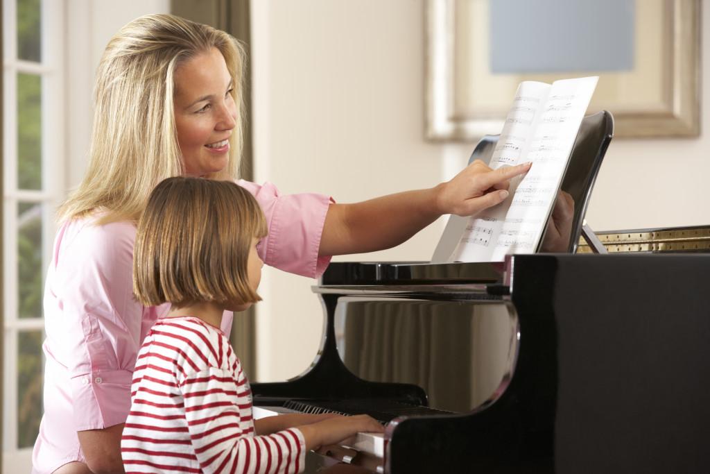 child taking piano lesson