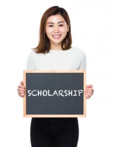person holding scholarship in board