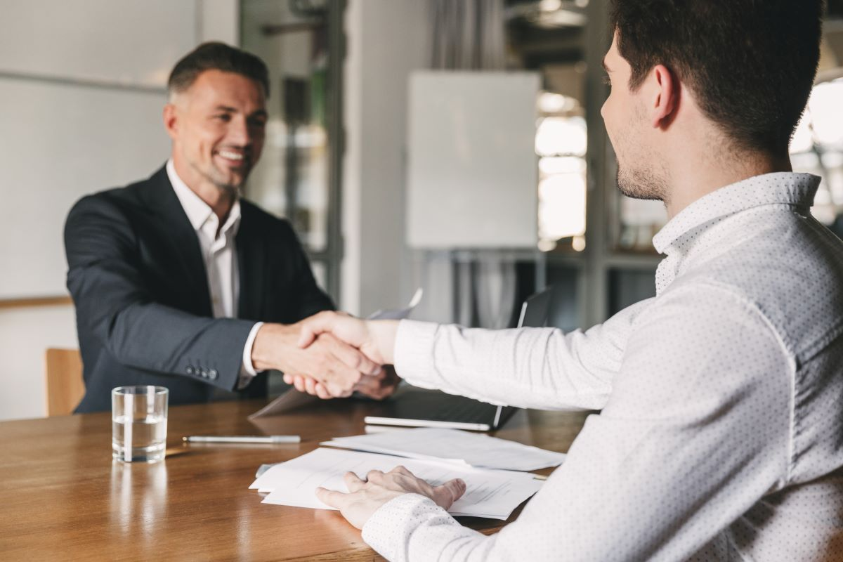 shaking hands at job interview
