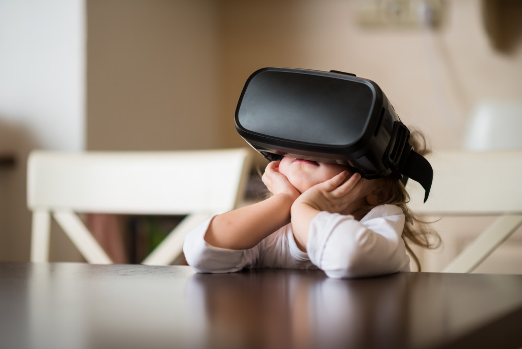 child wearing VR goggles